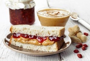 Peanut butter and jelly sandwich on plate for Peanut Butter Lovers Month